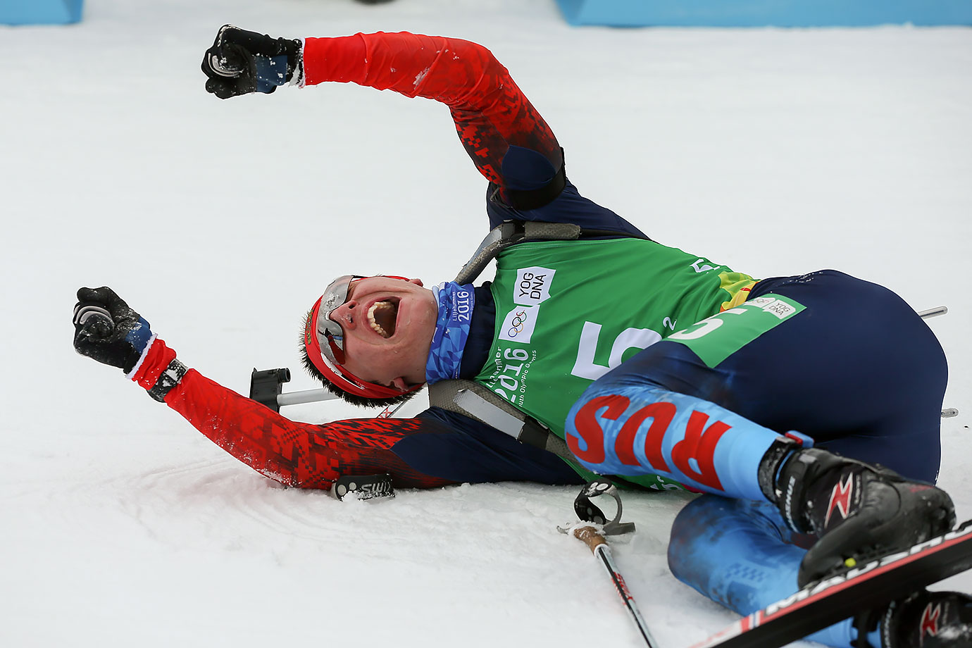 Egor Tutmin (RUS) celebrates after crossing the line to win a Bronze Medal in the Single Mixed Biathlon Relay at the Birkebeineren Biathlon Stadium on Feb. 17, 2016 during the Winter Youth Olympic Games in Lillehammer, Norway.