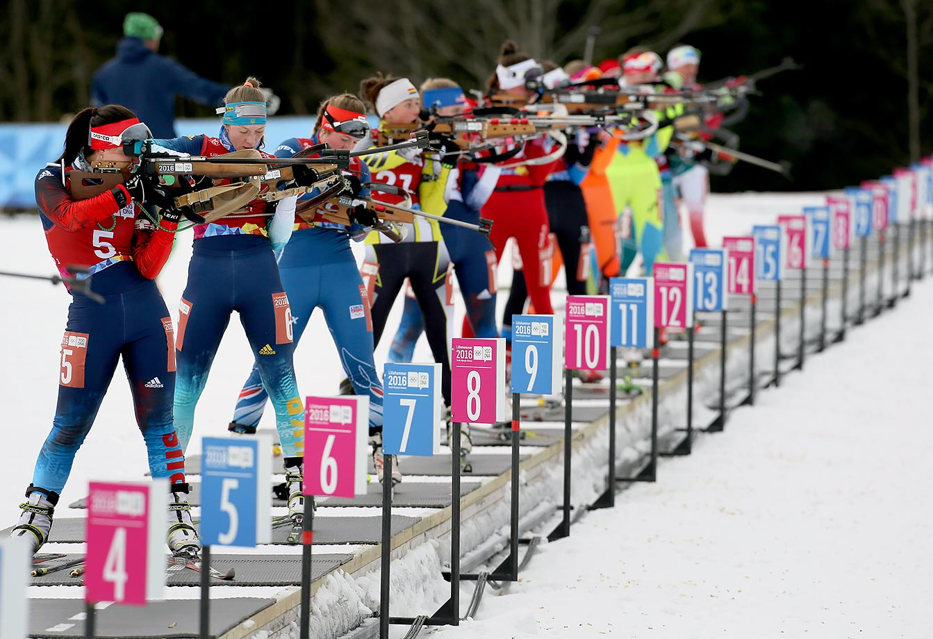 Competitors shoot rifles in the Single Mixed Biathlon Relay at Birkebeineren Biathlon Stadium on Feb. 17, 2016 during the Winter Youth Olympic Games in Lillehammer, Norway.