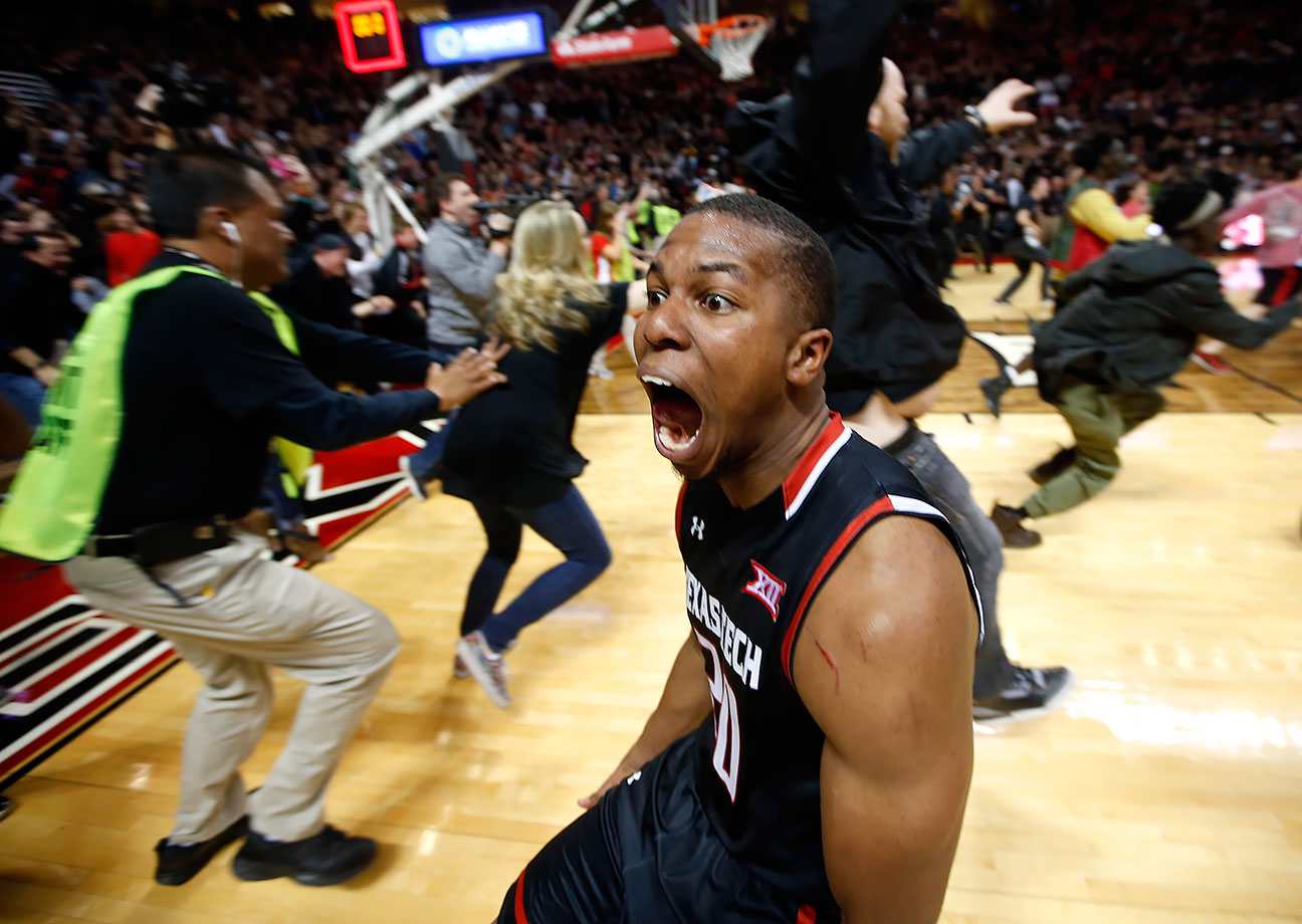 Texas Tech's Toddrick Gotcher runs toward fans to celebrate after their 65-63 win over Oklahoma in Lubbock, Texas.