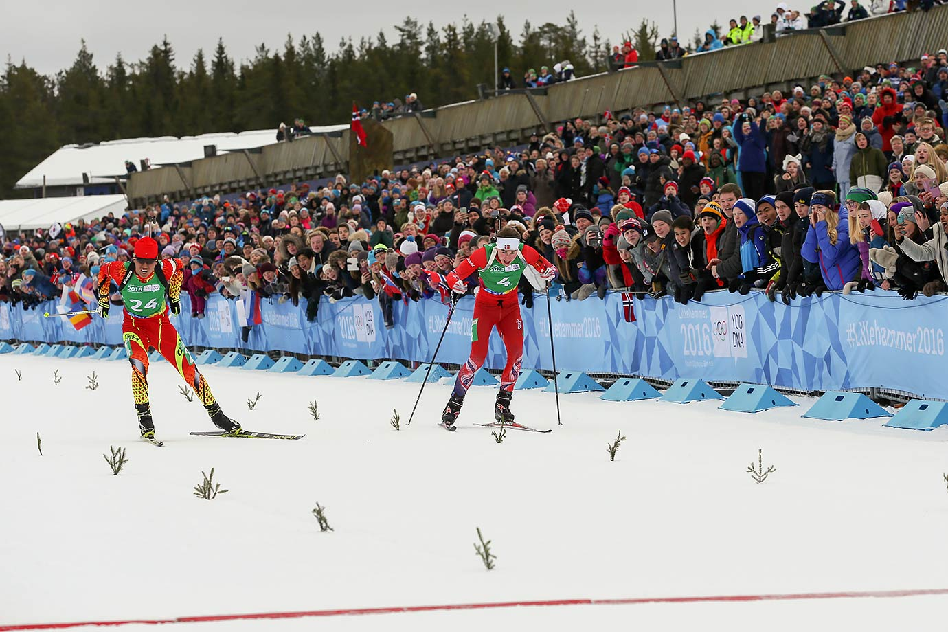 Zhenyu Zhu (CHN) crosses the line to take the Gold Medal ahead of Fredrik Qvist Bucher-Johanessen (NOR) in the Single Mixed Biathlon Relay at the Birkebeineren Biathlon Stadium on Feb. 17, 2016 during the Winter Youth Olympic Games in Lillehammer, Norway.