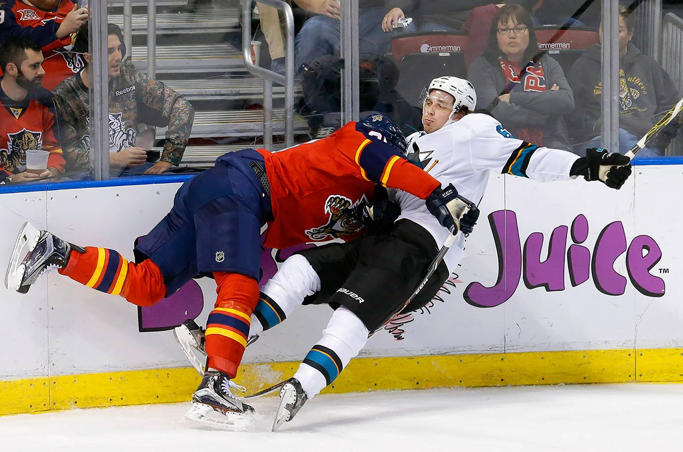 Florida Panthers left wing Garrett Wilson collides with San Jose Sharks defenseman Justin Braun during the second period of their game in Sunrise, Fla.