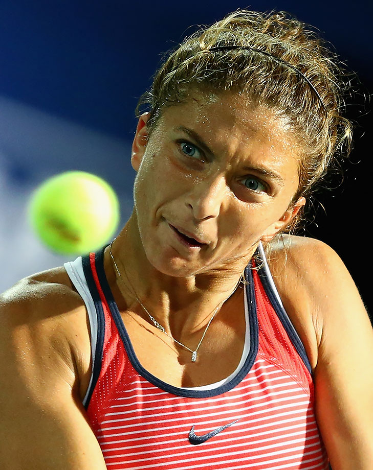 Sara Errani eyes the ball in her women's final match against Barbora Strycova during the WTA Dubai Duty Free Tennis Championship in Dubai, United Arab Emirates.