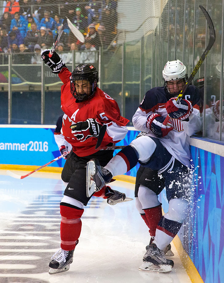 Benoit-Olivier Groulx (CAN) crashes into Mattias Samuelsson (USA) in the Ice Hockey men's final at the Kristins Hall on Feb. 21, 2016 during the Winter Youth Olympic Games in Lillehammer, Norway.