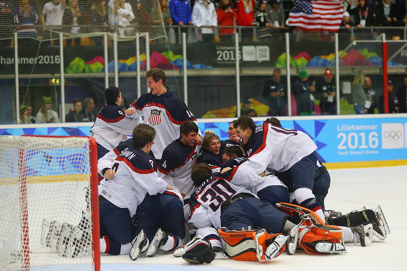 Team USA celebrates after winning 5-2 over Team Canada in the Ice Hockey men's final at the Kristins Hall on Feb. 21, 2016 during the Winter Youth Olympic Games in Lillehammer, Norway.