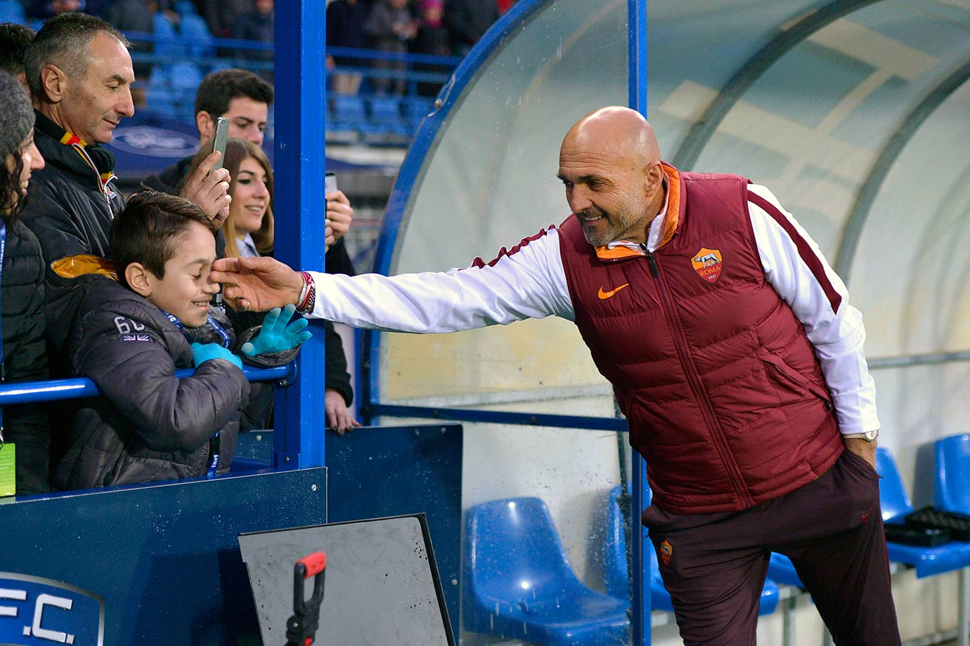 AS Roma head coach Luciano Spalletti jokes with a child before the Serie A match against Empoli FC in Empoli, Italy.