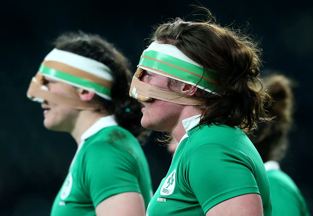 Paula Fitzpatrick and Ailis Egan of Ireland look on during the Women's Six Nations match against England in London.
