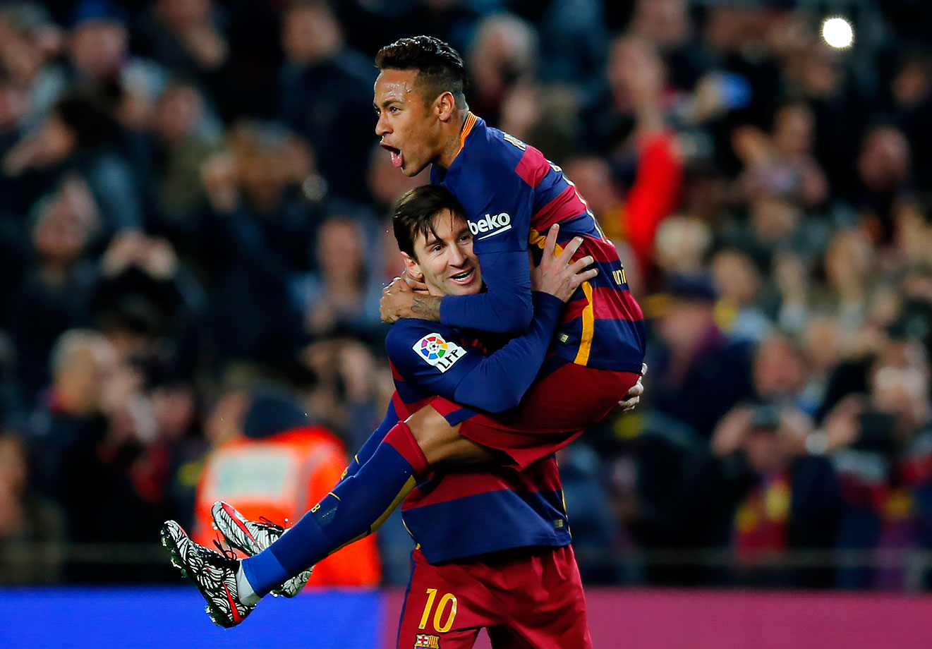 FC Barcelona's Lionel Messi celebrates after scoring against Sevilla with his teammate Neymar during a Spanish La Liga match in Barcelona, Spain.