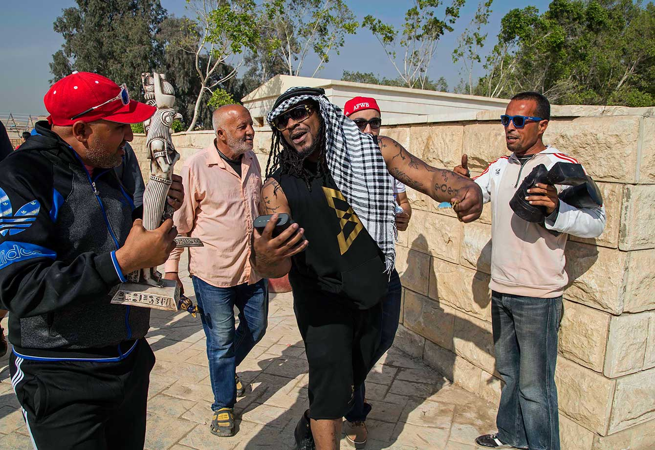Marshawn Lynch with American Football Without Barriers, a non-profit organization that educates disadvantaged children in the United States and overseas, visits the Pyramids of Giza in Cairo, Egypt.