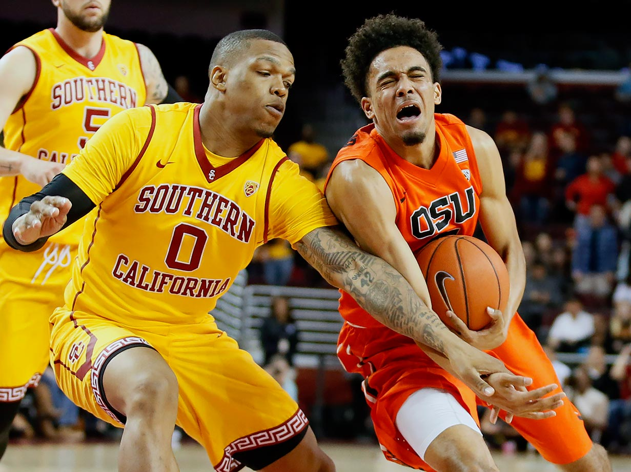 USC's Darion Clark defends against Oregon State's Stephen Thompson Jr. during the first half of a game in Los Angeles.