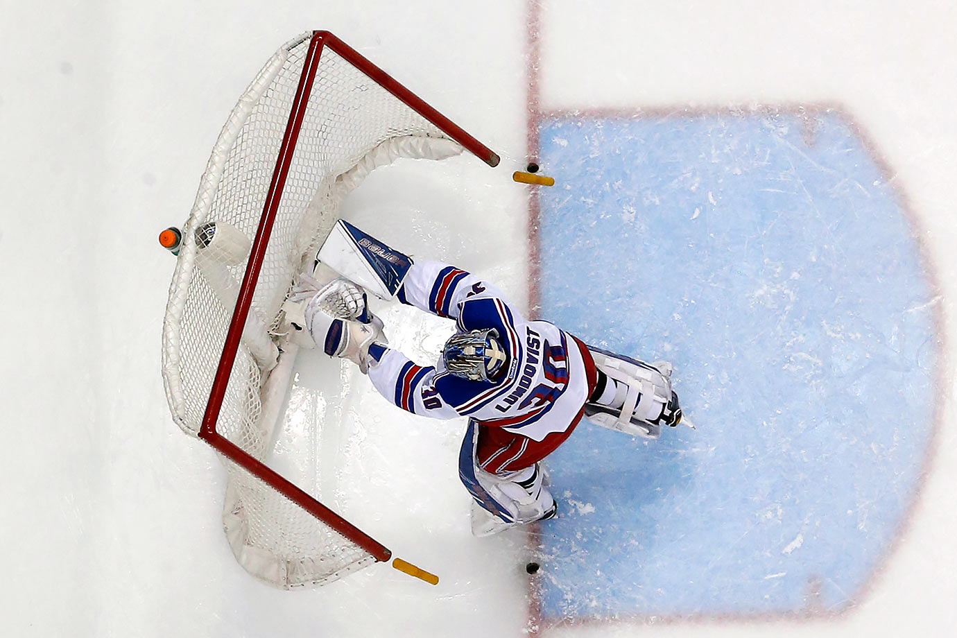 New York Rangers goalie Henrik Lundqvist pushes over the goal to force a stoppage of play after being shaken up in a collision with teammate Ryan McDonagh during the second period of a game against the Pittsburgh Penguins in Pittsburgh.