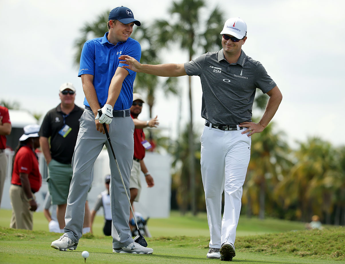 Jordan Spieth gets interrupted by Zach Johnson as he was about to hit from the third tee during the second round of the Cadillac Championship in Doral, Fla.