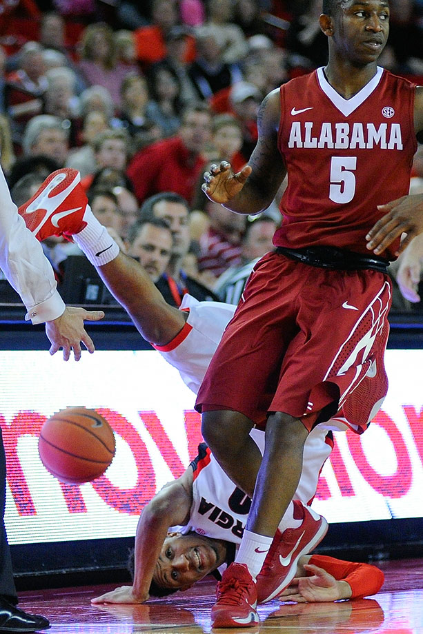 Georgia's J.J. Frazier flips over his head after being fouled by Alabama's Justin Coleman during the second half of a game in Athens, Ga.