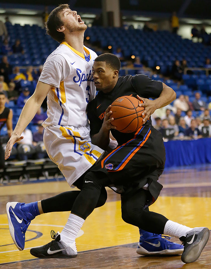 Boise State's Montigo Alford drives to the basket against San Jose State's Cody Schwartz during the first half of a game in San Jose, Calif.