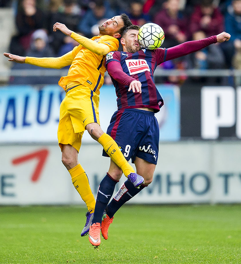 Sergi Enrich of SD Eibar duels for the ball with Sergio Busquets of FC Barcelona during the La Liga match in Eibar, Spain.