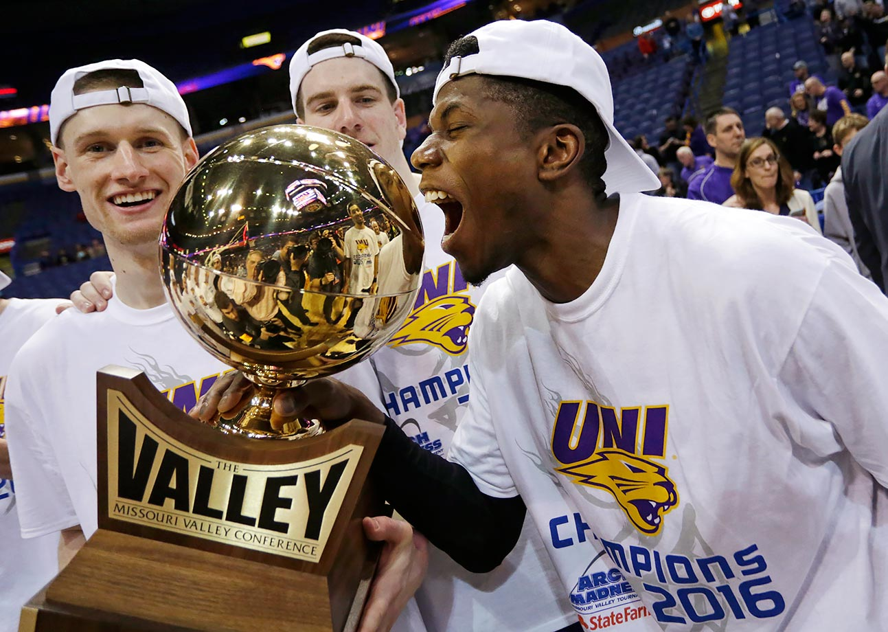 Northern Iowa's Wes Washpun reacts after kissing the championship trophy following their victory over Evansville in the Missouri Valley Conference men's tournament game in St. Louis.