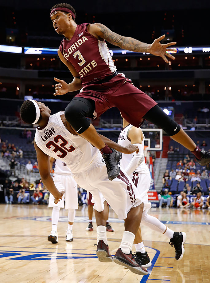 Florida State guard Benji Bell jumps past Virginia Tech forward Zach LeDay as Bell is fouled during the second half of their ACC Tournament game in Washington, D.C.