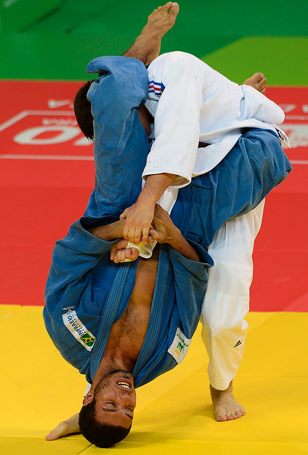 Nicolas Chilard of France grapples with an upside down Igor Pereira of Brazil at the International Judo Tournament in Rio de Janeiro, Brazil.