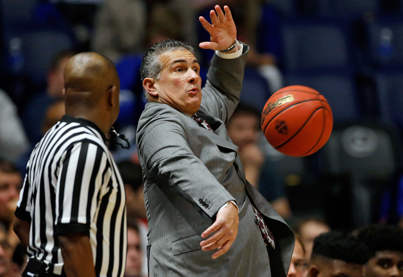 South Carolina head coach Frank Martin dodges a basketball as it sails out of bounds during the first half of their SEC Tournament game against Georgia in Nashville.