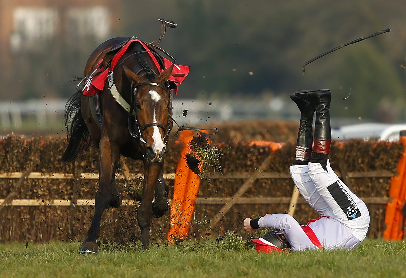 Jockey Jamie Moore is thrown from Le Boizelo at the last in The Team Army Handicap Hurdle Race at Sandown Park Racecourse in Esher, England.
