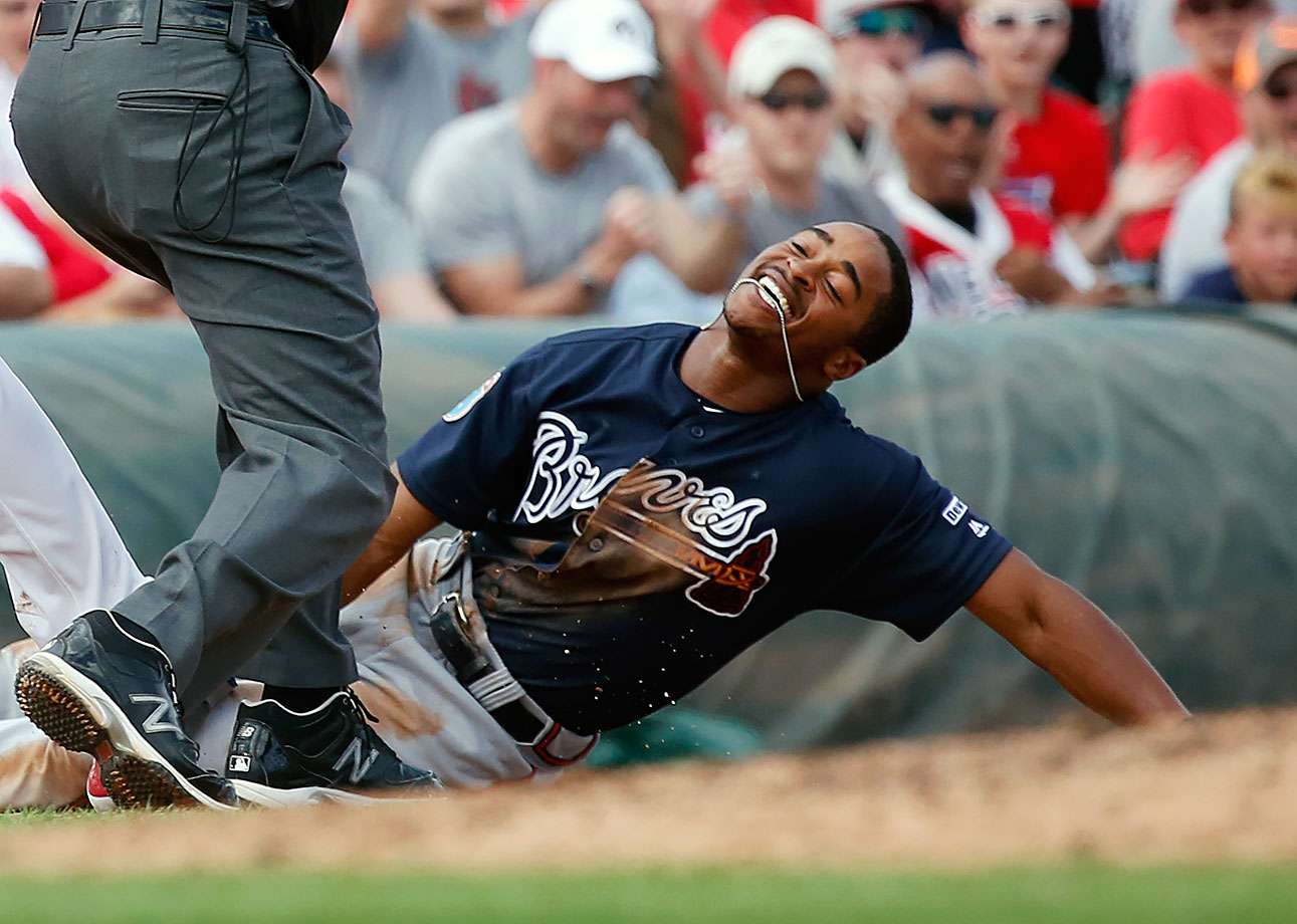 Atlanta Braves baserunner Mallex Smith reacts after being tagged out after an attempt to steal third base during the fourth inning of a spring training game against the St. Louis Cardinals in Jupiter, Fla.