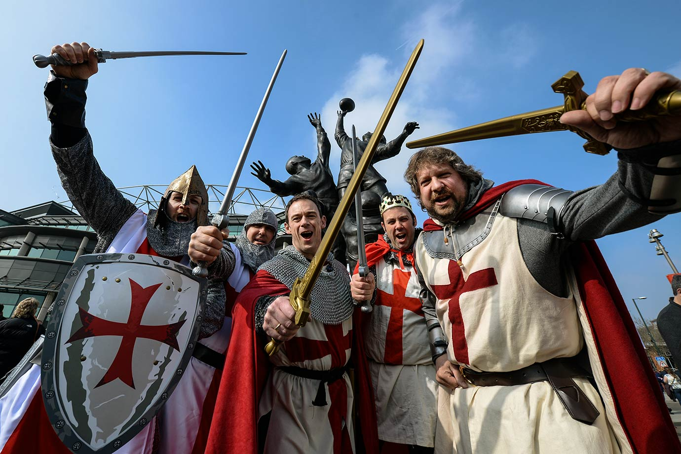 England rugby fans arrive at Twickenham Stadium dressed as knights under the 'Core Values' sculpture in the lead up to the England vs. Wales 6 Nations fixture in Twickenham, England.