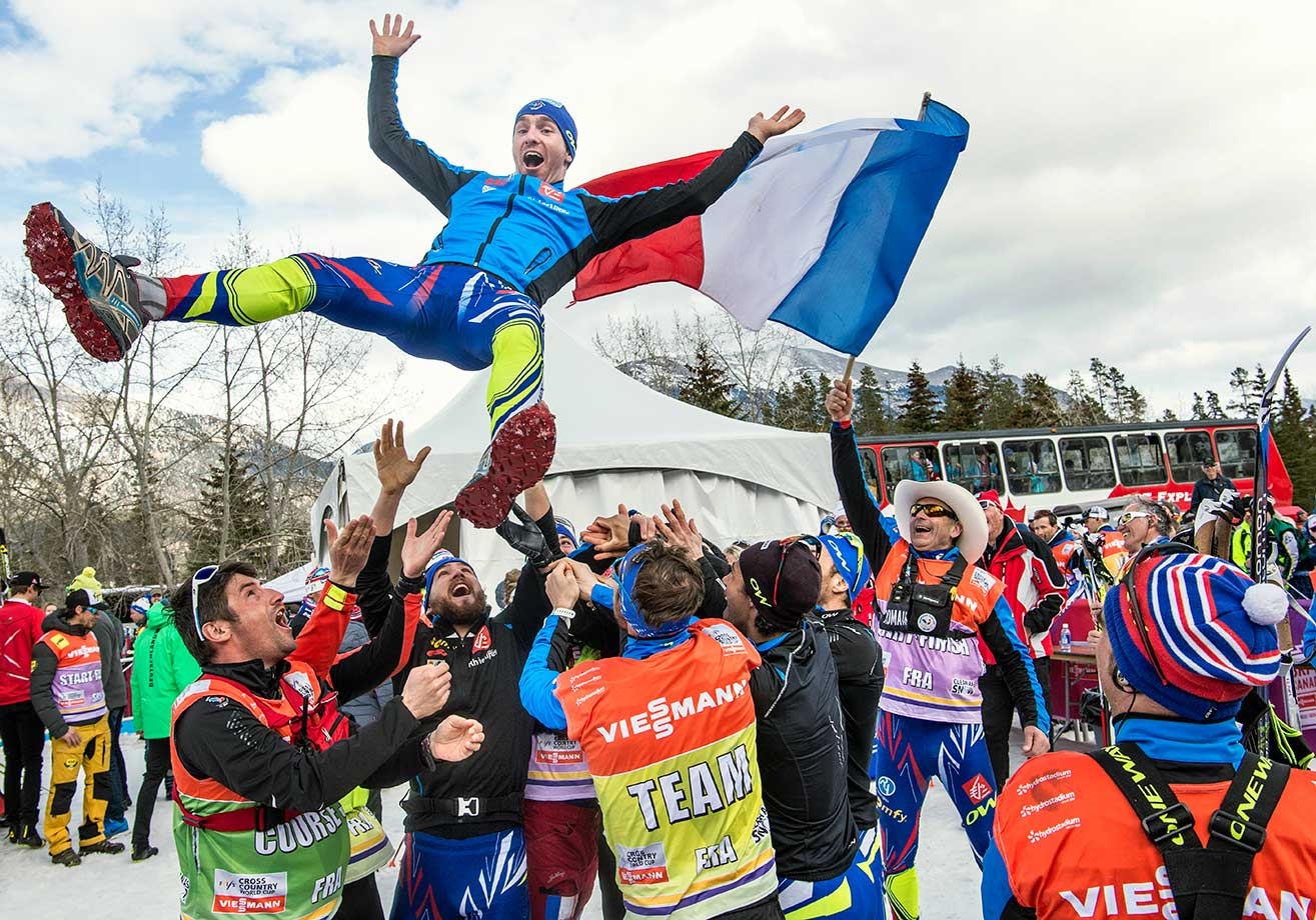 Maurice Manificat celebrates with Team France after winning the Cross Country Men's 15.0 km Pursuit Classic in Canmore, Canada.