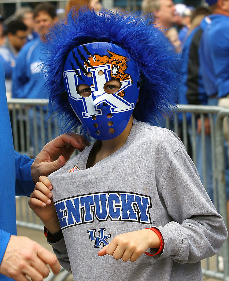 A young Kentucky fan waits outside before their SEC Championship Tournament game against Texas A&M in Nashville.