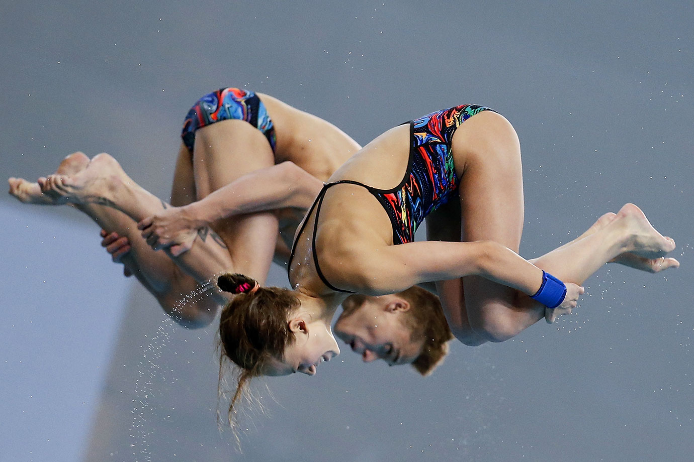 Nikita Shleikher and Yulia Timoshinina of Russia compete in the Mixed 10m Synchro Final during day three of the FINA/NVC Diving World Series in Beijing, China.