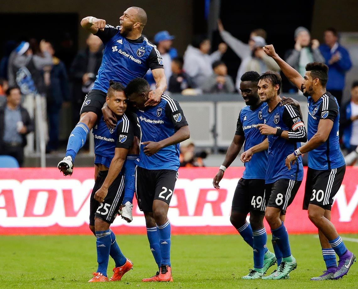 San Jose Earthquakes forward Quincy Amarikwa is mobbed by teammates after scoring against the Portland Timbers during the first half of their MLS game in San Jose, Calif.