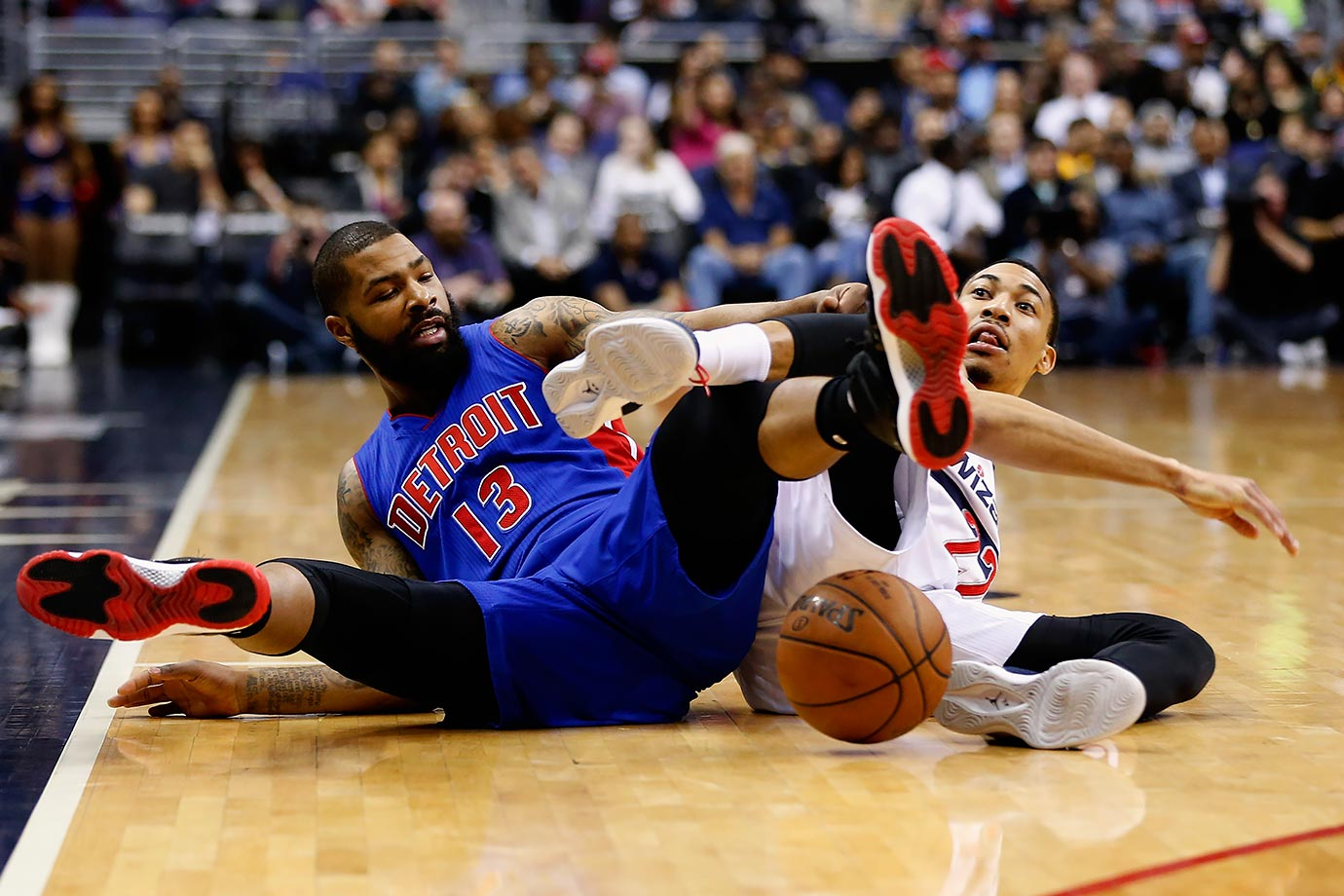 Detroit Pistons forward Marcus Morris and Washington Wizards forward Otto Porter Jr. go after a loose ball in the first half of their game in Washington, D.C.