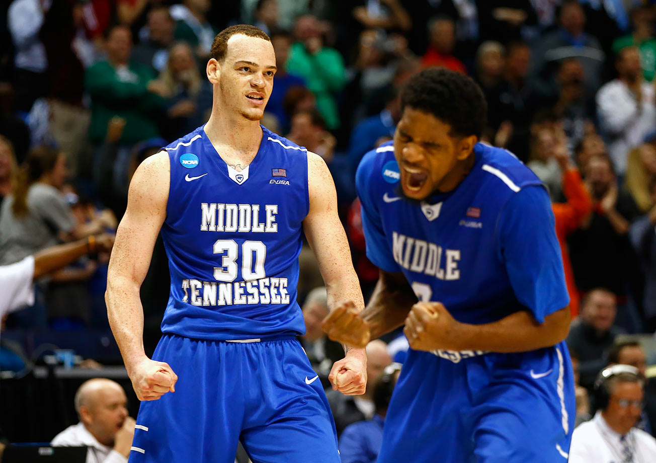 Reggie Upshaw (30) scored 21 points to lead the balanced 15th-seeded Blue Raiders, who shut down player of the year candidate Denzel Valentine, to a 90-81 win over No. 2 Michigan State in the first round of the tournament. Middle Tennessee never trailed the Spartans in one of the biggest upsets since the tournament began seeding teams in 1985.