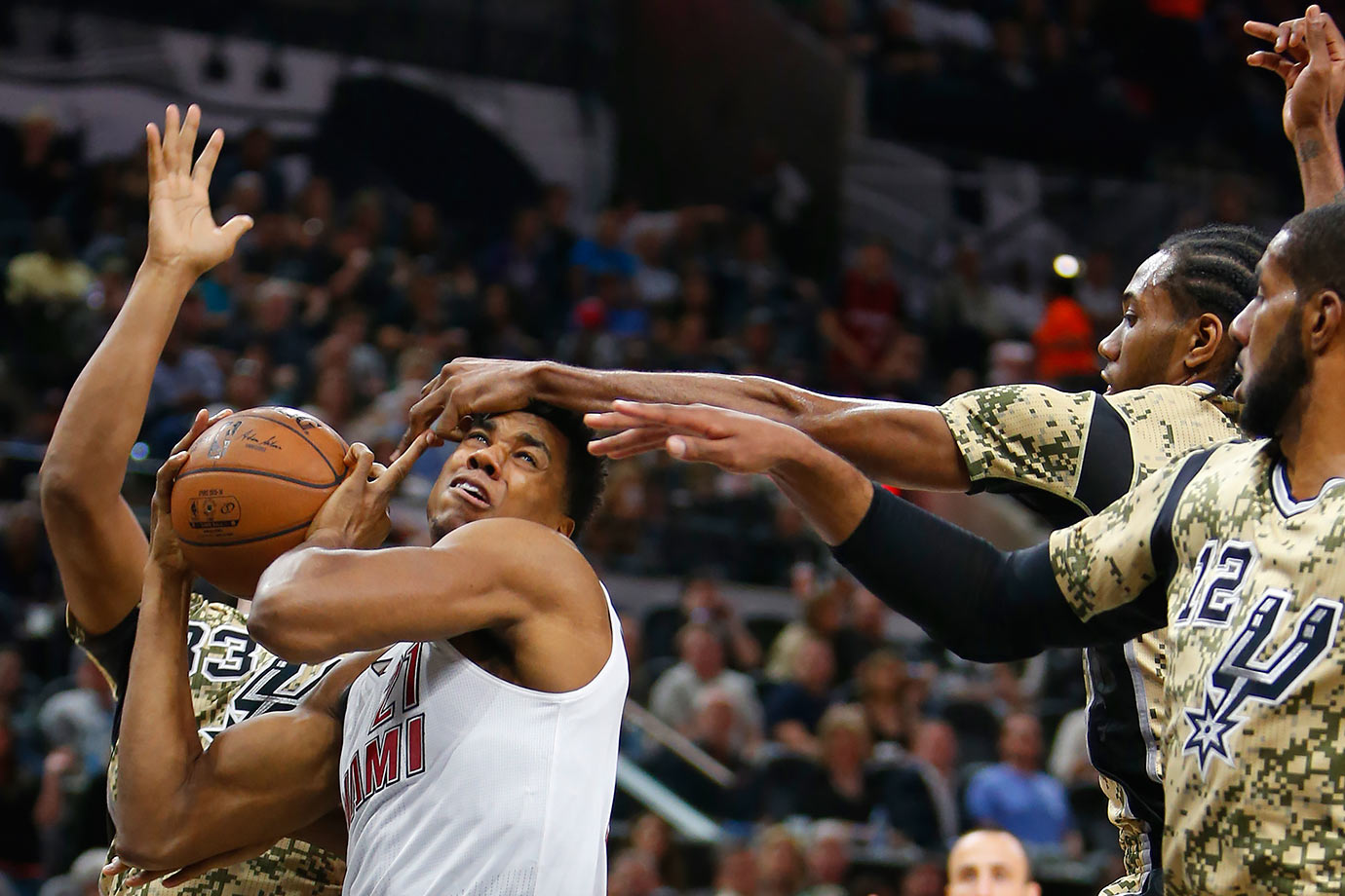 Miami Heat center Hassan Whiteside has his shot blocked by San Antonio Spurs forward Kawhi Leonard during their game in San Antonio, Texas.