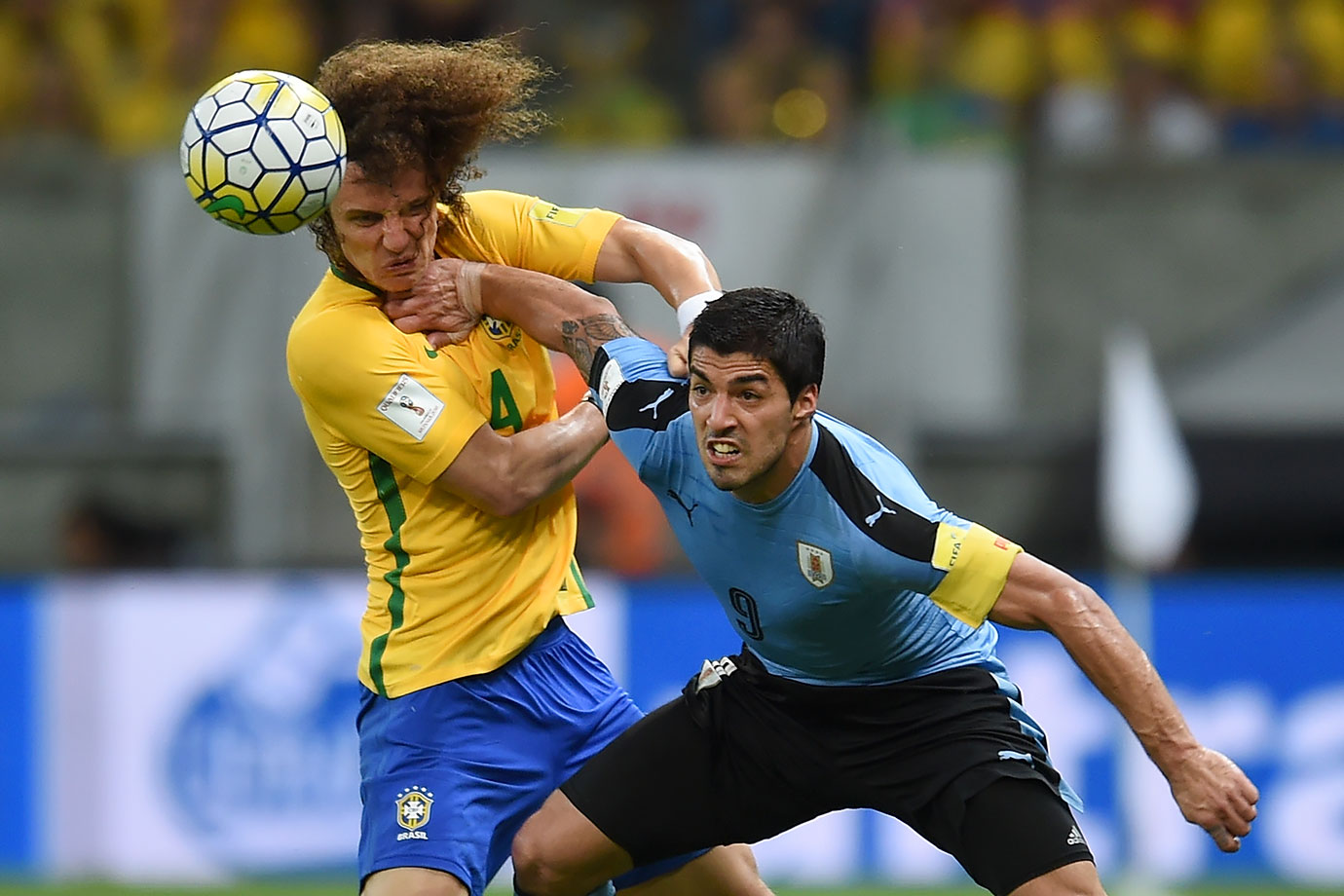 Brazil's David Luiz struggles for the ball with Uruguay's Luis Suarez during their 2018 FIFA World Cup Russia Qualifiers match in Recife, Brazil.