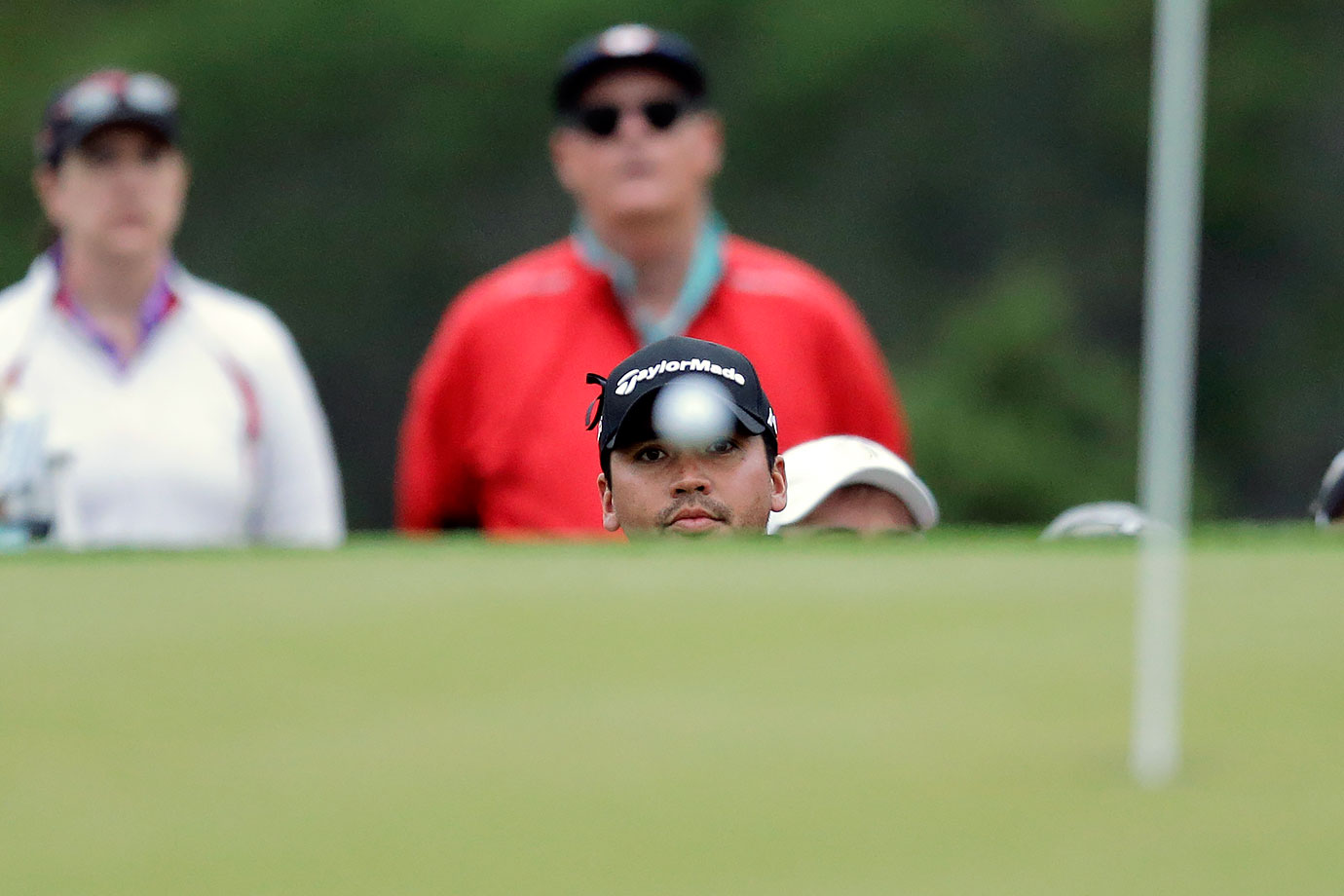 Jason Day watches his ball after chipping to the first green during the round of 16 play at the Dell Match Play Championship at Austin County Club in Austin, Texas.