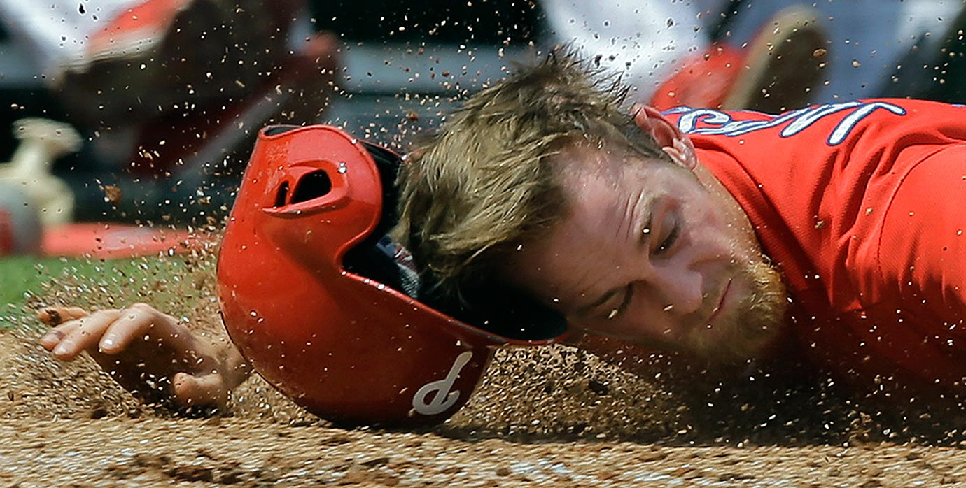 Philadelphia Phillies second baseman Ryan Jackson loses his helmet as he hits the dirt after getting tagged out during the third inning of a spring training game against the Detroit Tigers in Clearwater, Fla.