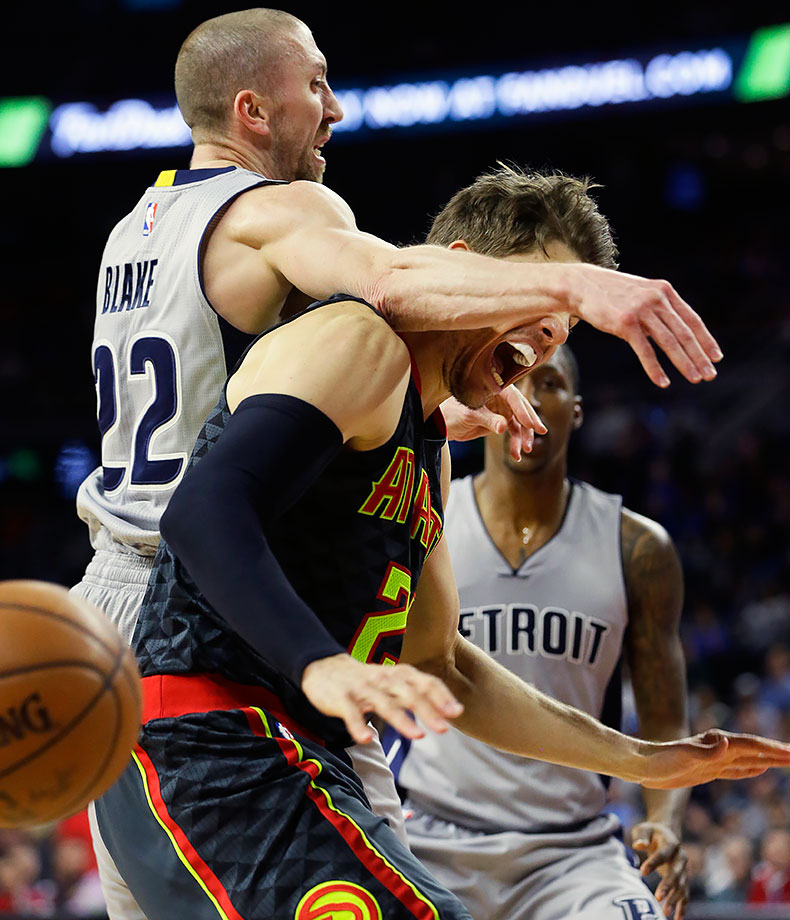 Atlanta Hawks guard Kyle Korver is fouled by Detroit Pistons guard Steve Blake during the second half of their gamein Auburn Hills, Mich.