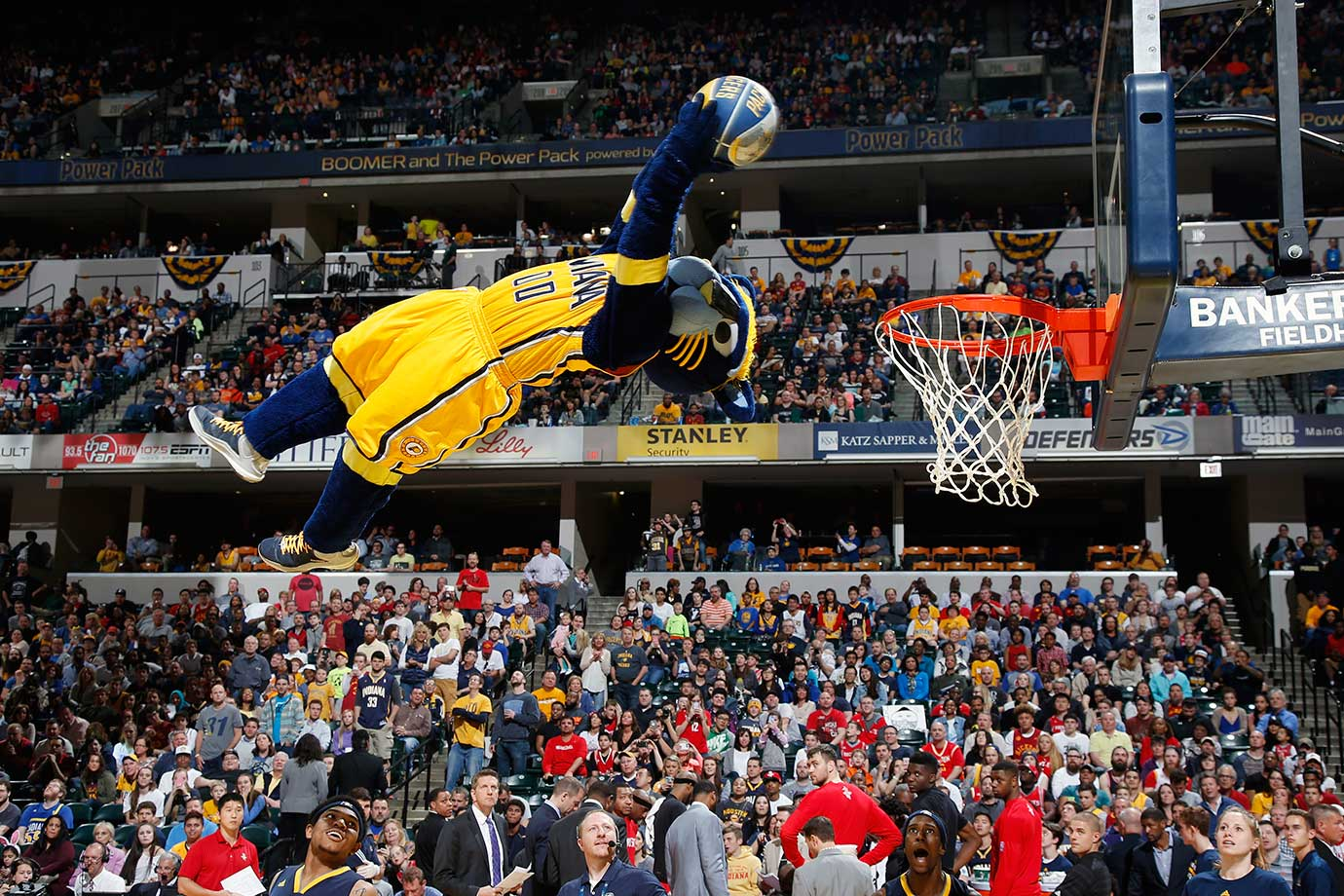Indiana Pacers mascot Boomer goes in for a dunk while performing during a timeout in a game against the Houston Rockets in Indianapolis.