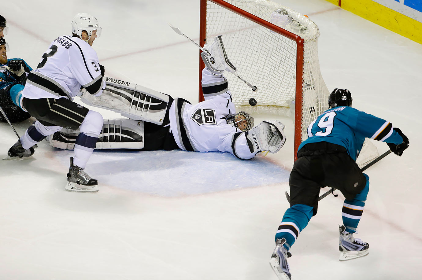 Los Angeles Kings goalie Jonathan Quick is beaten for a goal on a shot by San Jose Sharks center Joe Thornton during the third period of their game in San Jose, Calif.