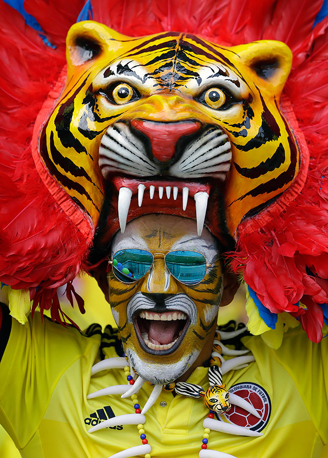A fan of Colombia's national team in a tiger costume cheers prior their 2018 FIFA World Cup Russia Qualifiers match against Ecuador in Barranquilla, Colombia.