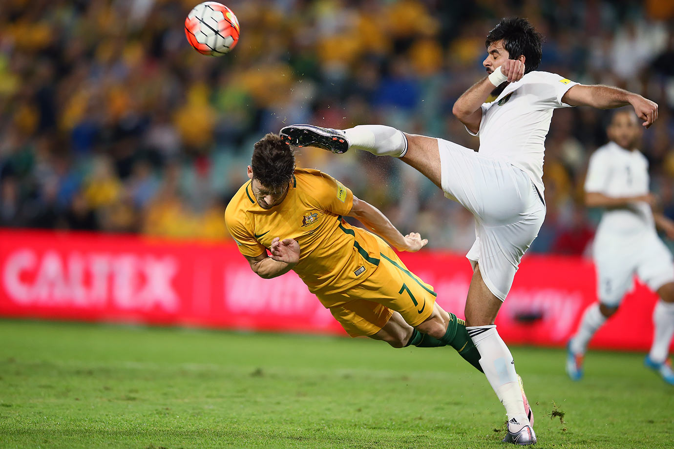 Australia's Mathew Leckie dives to head the ball as it is cleared by Jordan's Mohammad Al Basha during their 2018 FIFA World Cup Russia Qualifiers match in Sydney, Australia.