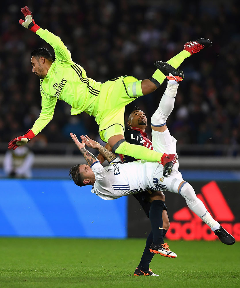 Real Madrid goalkeeper Keylor Navas collides with teammate defender Sergio Ramos and Kashima Antlers midfielder Fabricio during the FIFA Club World Cup Final match on Dec. 18, 2016 at International Stadium Yokohama, Japan.