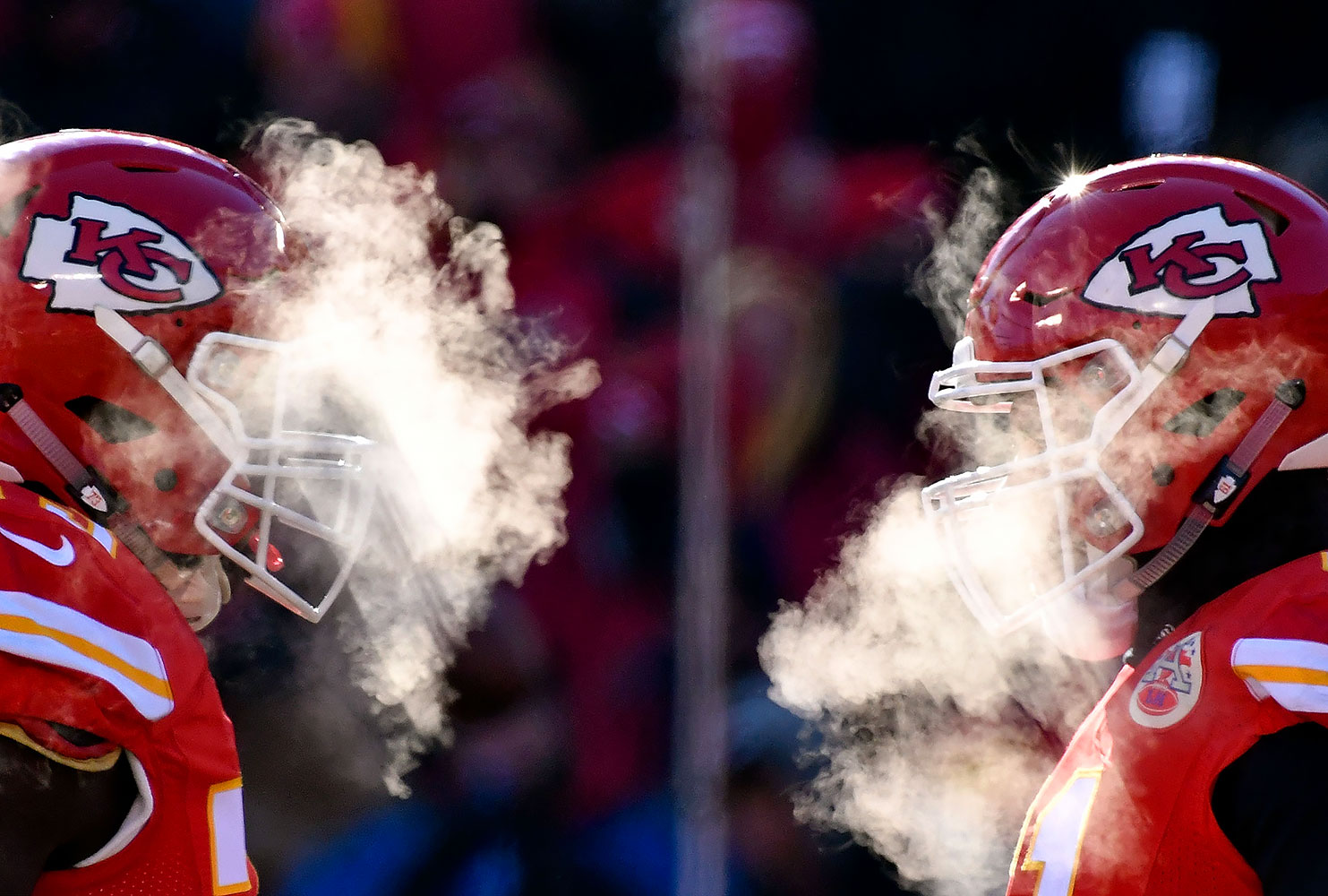 Kansas City Chiefs players' breath masks their faces during the game against the Tennessee Titans on Dec. 18, 2016 at Arrowhead Stadium in Kansas City.