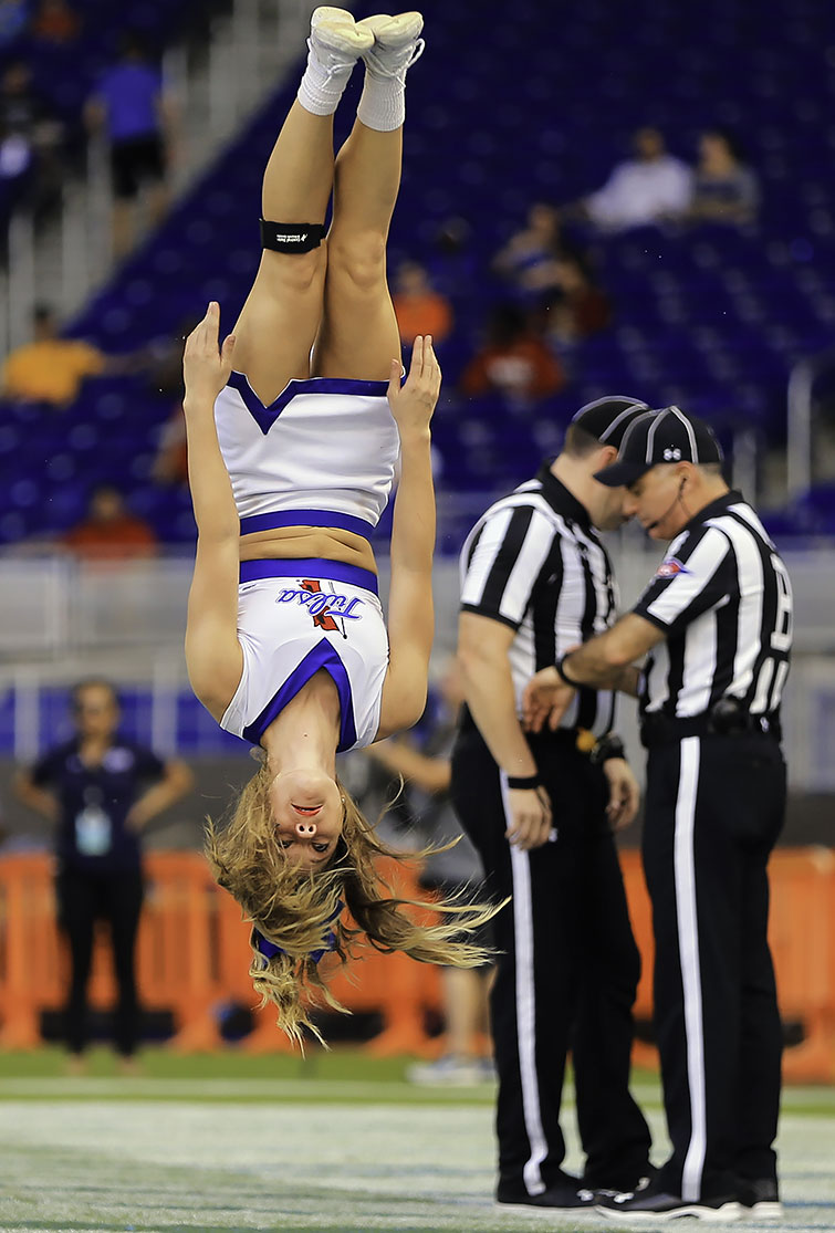 A Tulsa Golden Hurricane cheerleader performs during the game against the Central Michigan Chippewas on Dec. 19, 2016 at Marlins Park in Miami.