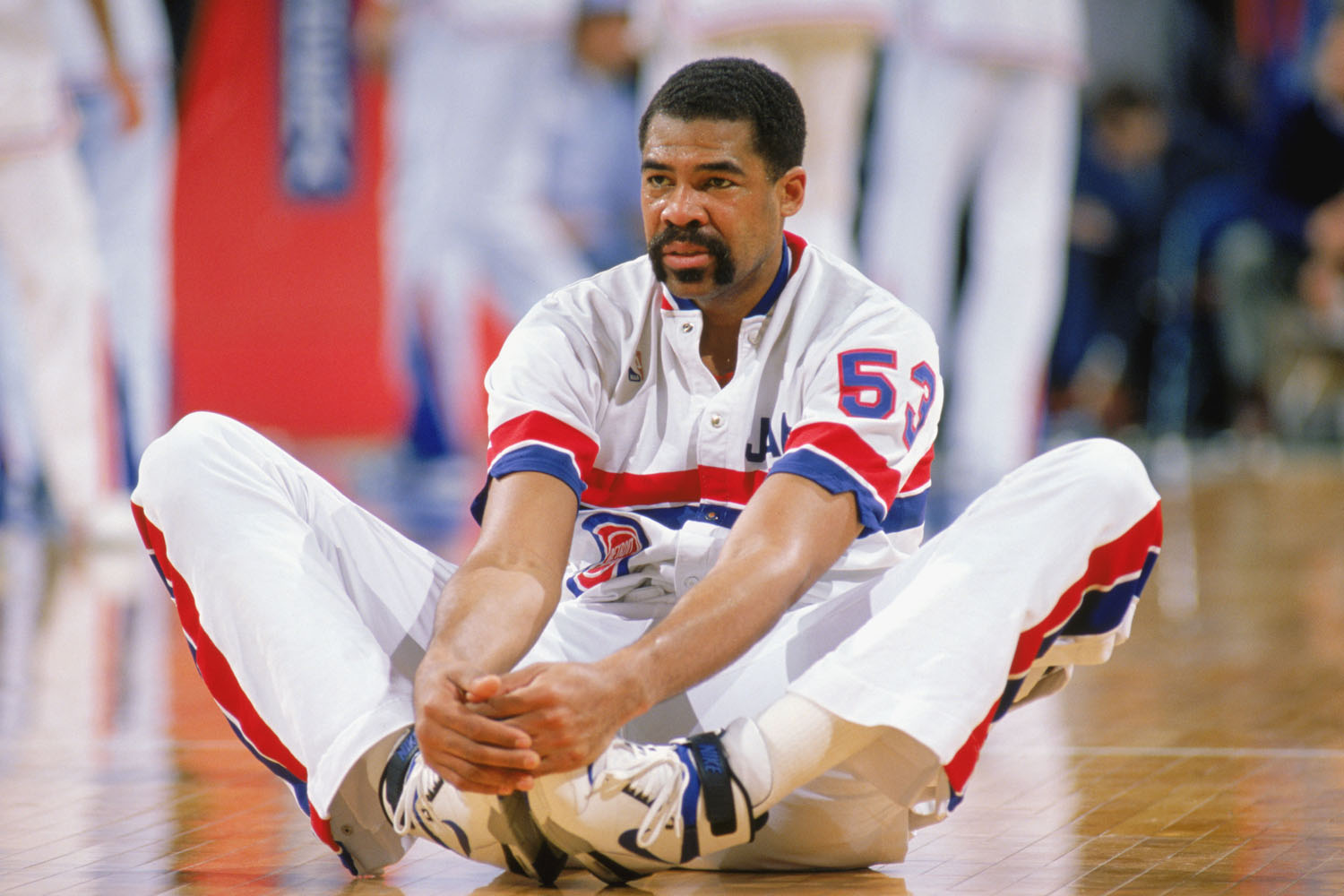 James Edwards stretches his legs before a regular season game in 1989.