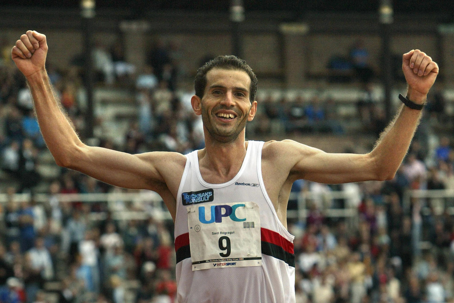 Said Regragui crosses the finish line in third place in his first ever marathon race at the Stockholm Marathon in June 2003.