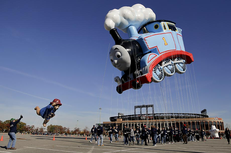 Handlers steer Thomas the Tank Engine and Paddington Bear balloons through the parking lot at CitiField on Saturday while practicing for the 88th Annual Macy's Thanksgiving Day Parade. Thomas will be the parade's largest balloon by helium volume and the one containing the most balloon fabric ever used on one character.