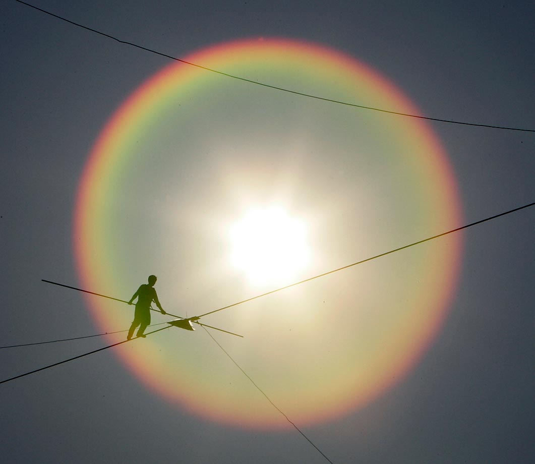 South Korean Kwon Won-tae walks a high wire during the World High Wire Championships in Seoul, South Korea. Twenty-seven high wire walkers from 14 countries challenged on the high wire, a wire rope 30 millimeters in diameter stretching 1,000 meters across the Han River in Seoul.