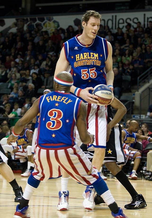 "Paul (Tiny) Sturgess, standing 7' 8"", is not only the tallest Harlem Globetrotter but also the tallest person to ever play professional basketball."