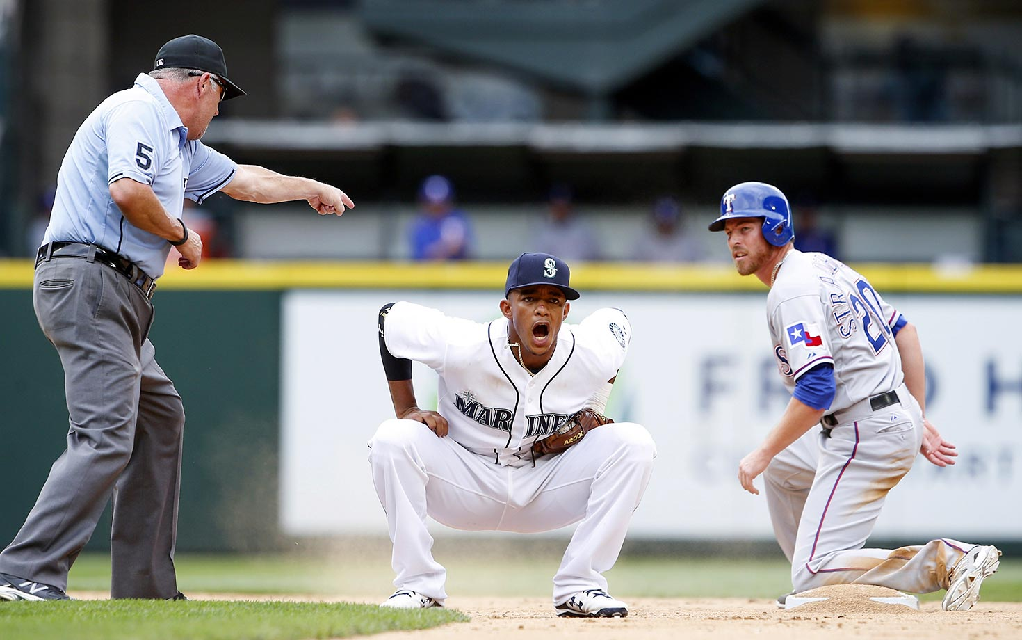 Seattle Mariners shortstop Ketel Marte reacts after missing a double play against Ryan Strausborger of the Texas Rangers.