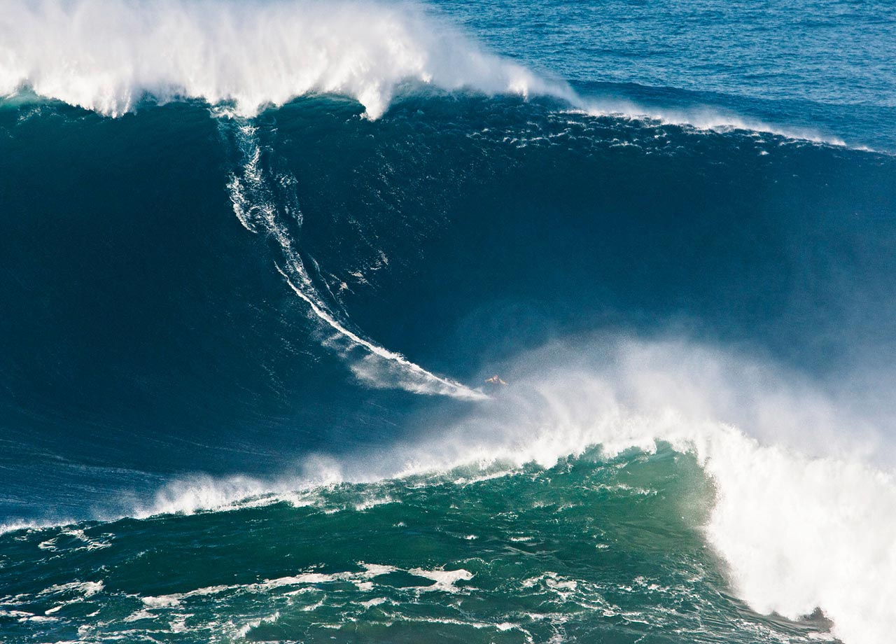 Garrett McNamara of Haleiwa, Hawaii, won the Biggest Wave surfed title, a 78-foot wall caught at Nazare, Portugal. Carlos Burle of Brazil may have broken the record, also at Nazare, on Oct. 28, 2013, once the wave is properly measured by Guinness.